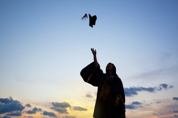 Young Female Student Celebrating Graduation Senior Year to get an entry level job